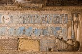 stock photo of pisces  - Astrological symbols carved and painted onto the ceiling of Dendera Temple near Qena, Egypt.  The goddess of the night Nut is enclosing the ceiling with her body and arms.  The Pisces fish can be seen towards the top left.
