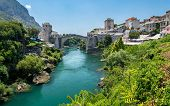 Historic River Bridge And The Famous Sights Of The Balkan. Mostar, Bosnia And Herzegovina. poster