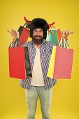 Keep Smiling And Carry On Bags. Bearded Man Smiling With Paper Bags After Seasonal Sale. Happy Hipst poster