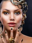 Golden Makeup and Jewelry.Fashion Model Portrait
