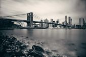 Pebble beach with Brooklyn Bridge and downtown Manhattan skyline in New York City poster