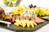 Catering buffet cheeseboard and pate, grapes and walnuts cheeseboard