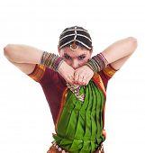 picture of bharatanatyam  - Bollywood dancer in green and orange folded dress posing as cobra - JPG