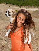 Beautiful mountain shepherd girl from Bulgaria posing with her puppy
