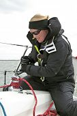 Woman in action during a sail competition on the IJsselmeer in the Netherlands