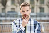 Trim Or Shave. Unshaven Guy Touch Beard Hair Outdoor. Handsome Man Wear Beard. Bearded Man With Styl poster