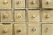 drawers of primitive vintage grunge wood apothecary cabinet