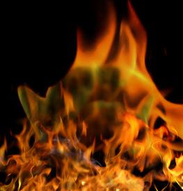 picture of rebs  - A reb bonfire against a black  burning background - JPG