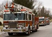 stock photo of fire truck  - fire trucks on the scene of a reported flue fire in a quiet residential area - JPG