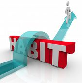 stock photo of overcoming obstacles  - A man jumps over the word habit on an arrow - JPG