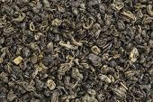 Chinese gunpowder (pearl) green tea - background texture of loose leaf