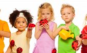 stock photo of water bug  - Group of kids with toy spring lady bugs and watering can - JPG