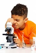 pic of ten years old  - black ten years old boy on biology class using microscope - JPG