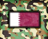 stock photo of ami  - Amy camouflage uniform with flag on it Qatar - JPG