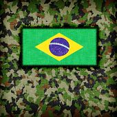 stock photo of ami  - Amy camouflage uniform with flag on it Brazil - JPG