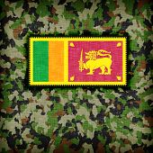 stock photo of ami  - Amy camouflage uniform with flag on it Sri Lanka - JPG