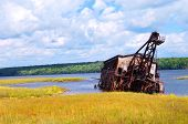 image of suction  - Abandoned copper reclamation suction dredge sits in the waters of Torch Lake in Upper Peninsula Michigan - JPG
