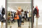 stock photo of shopping center  - Photo of the Shoppers at shopping center motion blur - JPG