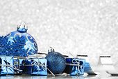 Christmas card with blue decoration on silver background