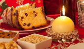 picture of pecan  - Decorated Christmas Dinner Table Setting with food and candles - JPG