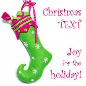 Colorful handcrafted curly toe Christmas stocking on white background with copy space.