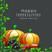 Happy Thanksgiving Day background with fruits, vegetables and green leaves on dark grey background.