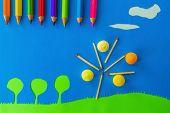 Children's play: apple tree on blue sky