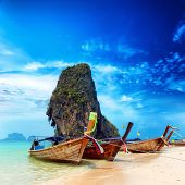 Thailand exotic sand beach and boats in asian tropical island. Beautiful tourism destination travel landscape background poster
