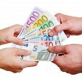 Hands arguing over different Euro money bills
