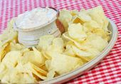 stock photo of potato chips  - Potato Chips and Onion Dip in a tilted composition - JPG