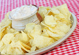image of potato chips  - Potato Chips and Onion Dip in a tilted composition - JPG