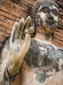 picture of mudra  - Ancient Buddha statue in Vitarka mudra posture - JPG