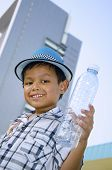Child holding a water bottle