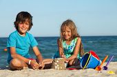 stock photo of conch  - Kids playing in the sand  - JPG
