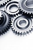 Closeup of metal cog gears on plain background. Copy space