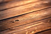 image of scratch  - Old wood scratched surface in gold light of sunset with macro details