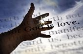 stock photo of scriptures  - Detail closeup God is love scripture in bible verse - JPG