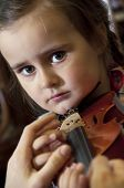 picture of first class  - Adorable 3 year old little girl learning playing violin on music school class - JPG