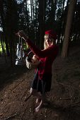 stock photo of little red riding hood  - little red riding hood in the forest