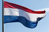 stock photo of holland flag  - A Holland flag in the wind in sky - JPG