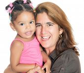 Close up portrait of a mother carrying her small multiracial daughter isolated on white