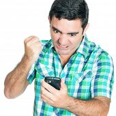 Angry man punching his mobile phone (isolated on white)