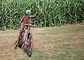 picture of metal sculpture  - A metal sculpture of a bicycle and rider waves to passerbys - JPG