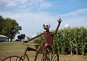 pic of metal sculpture  - A metal sculpture of a bicycle and rider waves to passerbys - JPG