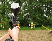 image of paintball  - View of Paintball women aiming with marker - JPG
