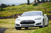 San Francisco, CA - April 2014: Tesla Motors model S sedan electric car on country road, Tesla's new