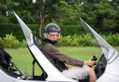 pic of gyrocopter  - Woman pilot sitting in the autogyro on the small rural airdrome - JPG