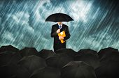 pic of gathering  - Insurance agents in heavy rain - JPG