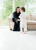 image of arabic  - Arabic mother with baby at home - JPG