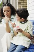 Mother and son eating ice cream together